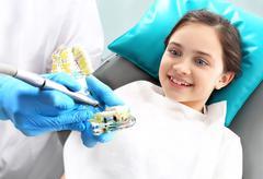 Dentistry, joyful child in the dental chair Stock Photos