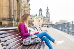 Woman tourist writes his impressions in a diary, Dresden, Germany - stock photo
