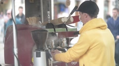 A man prepares a coffee outdoors in the coffee machine - stock footage