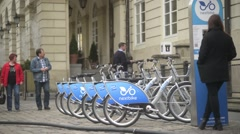 Lviv Lvov historical center city - Pedestrians and bikes rent - Ukraine Stock Footage