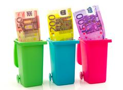 Colorful recycle bins with euro money inside Stock Photos