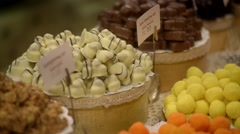 The seller in the candy store shop puts chocolates in a showcase - Lvov, Ukraine Stock Footage
