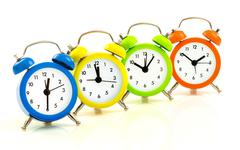 Colorful alarm clocks Stock Photos