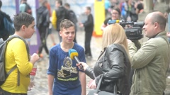 Lvov Lviv Lemberg Water Festival - journalists talks with two wet boys Stock Footage