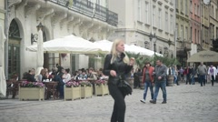 Croud of tourists walking through the old streets of Lvov Lviv - spring day - stock footage