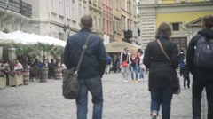 Croud of tourists walking through the old streets of Lvov Lviv - spring day Stock Footage