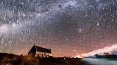 Aurora Borealis and Star Trails, Good Shepherd Church. Zoom Out Stock Footage
