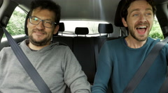 Two handsome men friends laughing driving car happy 4K Stock Footage