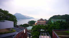 Stanley Beach harbour, Hong Kong  Lighted Murray House and plaza - stock footage