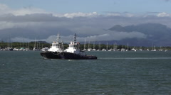 Two tugboats sail in Cairns Queensland Australia - stock footage
