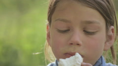 Portrait of a white-skinned child with marshmallows in hand. Stock Footage