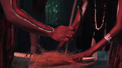 Aboriginal people light fire from by rubbing sticks Stock Footage