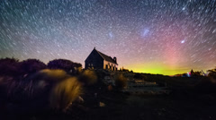 Aurora Borealis and Star Trails, Good Shepherd Church. Zoom In - stock footage