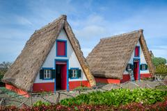 Old traditional Madeira explorer's houses - the symbol of island - stock photo