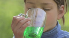 Portrait of a white-skinned boy with lemonade. Stock Footage