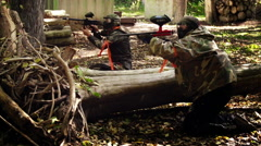 Paintball hiding behind armoury Stock Footage