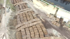 Logging Industry - Aerial of log pile - stock footage