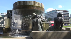 Fountain Stages of Live sculptures, a sitting couple, lying girl. Stock Footage