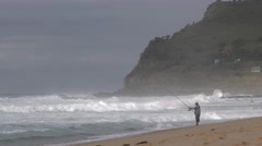 Surf Fishing in Ocean Waves from Beach Shore in Australia Coast Stock Footage