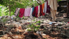 Hanging laundry in slum South East Asia Stock Footage