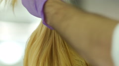 Stylist hairdresser makes hair coloring Stock Footage