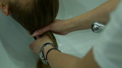 Hair washing is the cosmetic act of keeping hair clean Stock Footage