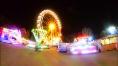 Night carousel in the bright lights. ride a ferris wheel - stock footage