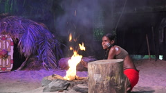 Aboriginal people light fire from by rubbing sticks - stock footage