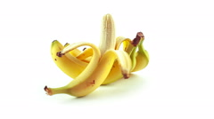 Peeled banana and a bunch of bananas Stock Footage
