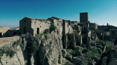Footage of deserted houses in ghost town on the mountain. Aerial video N. Stock Footage