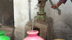 India pumping water out of well Stock Footage
