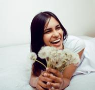 cute mulatto indian girl with dandelion smiling, lifestyle people concept - stock photo