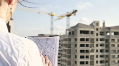 Architect looking on project on construction site Stock Footage