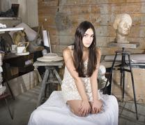 young pretty girl model in painter studio posing among stuff, lifestyle people - stock photo
