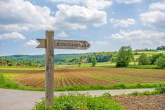 Signpost labeled with rifle association's clubhouse (Schuetzenhaus) Stock Photos
