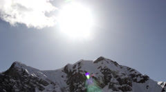 Panorama of Snow-Capped Mountains With Patches of Light From the Sun, Panorama Stock Footage