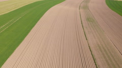 Aerial: Mid Air Shot of Multicolored Fields Stock Footage