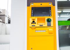 yellow ATM machine - stock photo