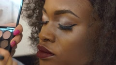 Close-up portrait of attractive black female model with bright makeup in studio Stock Footage