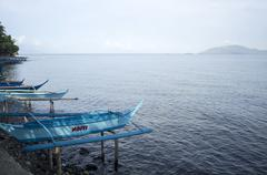Parked Boat at sea shore - stock photo