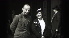 1937: Cold nazi officer poses with attractive women breaks small smile to seem - stock footage