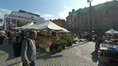 Hötorget sunday market in central Stockholm in Summer sunshine Stock Footage