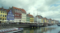 Shopping street with colorful buildings and water canal in Copenhagen Stock Footage