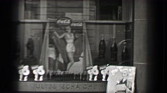 1937: Coca Cola advertising in German storefront aryan race women idolatry. Stock Footage
