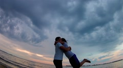 Slow Motion couples circling on the background of evening clouds and river waves - stock footage