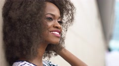 Close-up portrait of an attractive young african american woman charmingly Stock Footage