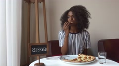 Elegant vegeterian african american woman eating pizza with no meat. Business Stock Footage