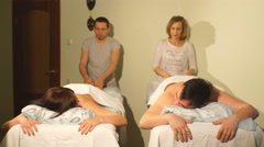 man and woman doing couples massage - stock footage