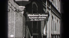 1937: Hitoholfreies Gpeifehaus building sign traditional street view. BERLIN, Stock Footage