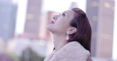 Beautiful Asian woman in gold dress under fur coat in Downtown LA 4K Stock Footage